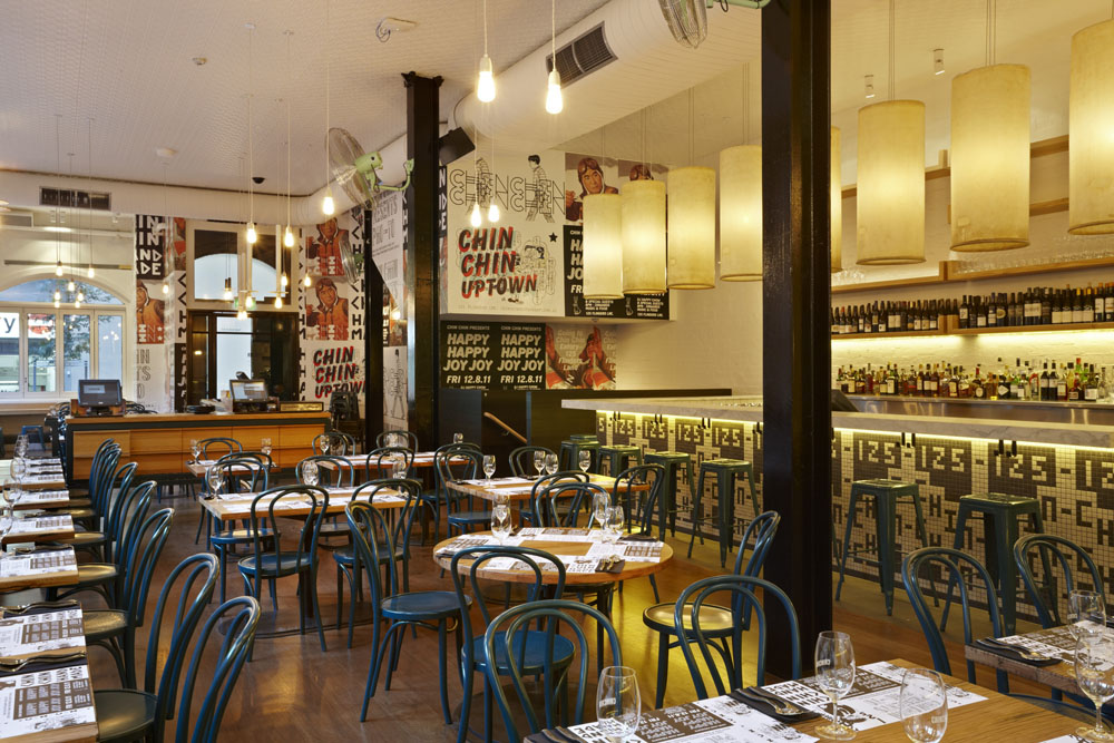 Inside modern restaurant with postered walls